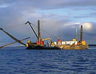 Boat with oil deployment equipment