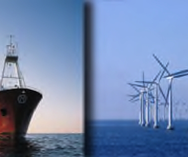 Wind turbines & boat in ocean