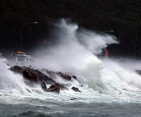 Huge wave washes over causeway